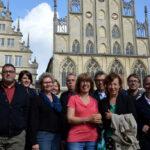 High-Level-Group zu Besuch in Münster: Ein Gruppenbild vor dem schönen alten Rathaus in Münster.